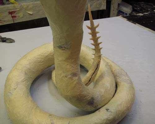add cloth to paper mache snake
