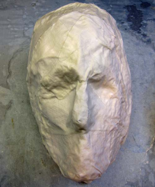 cloth mache impression of face