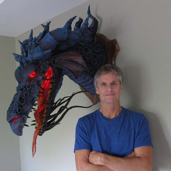dan reeder with paper mache dragon trophy