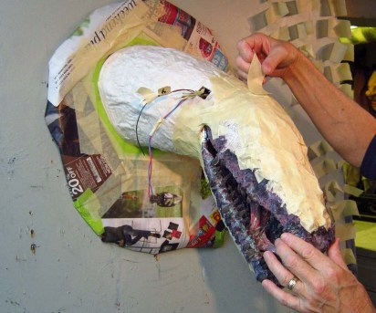 taping on the paper mache jaws